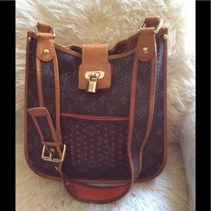 Louis Vuitton perforated musset